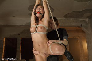 Brunette babe with a gag-ball gets bound - XXX Dessert - Picture 2