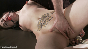 Tattooed bitch gets roped to the tabled  - Picture 3