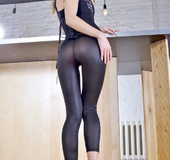 Blond wearing tights that are like a second skin peels off everything
