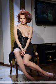 slender redhead black lingerie