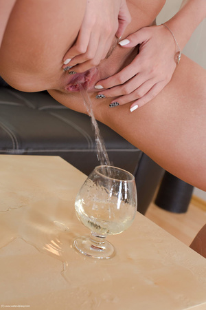 Excellent beaver in a white blouse and black pantyhose pisses in a goblet. - XXXonXXX - Pic 13