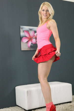 Charming girl in a pink top and red skirt pisses in her red shoe. - XXXonXXX - Pic 1