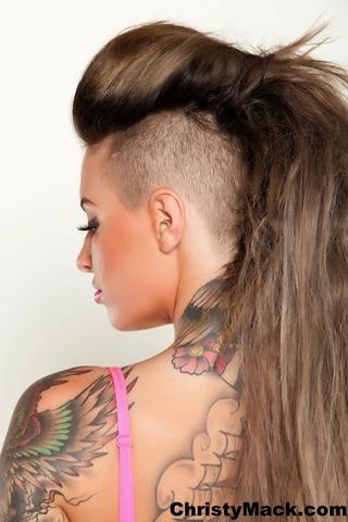 tattooed chick posing alluring