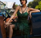 Gorgeous chick goes retro as she fabulously poses in an elegant green