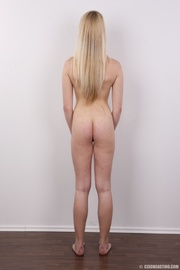 small-titted blondie stands her