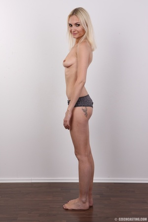 Slim blonde girl with a tattoo stands a  - XXX Dessert - Picture 10