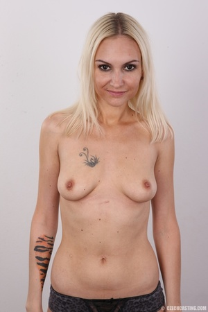 Slim blonde girl with a tattoo stands a  - XXX Dessert - Picture 11
