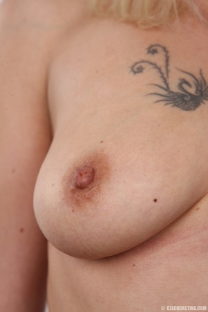 Slim blonde girl with a tattoo stands a  - XXX Dessert - Picture 12