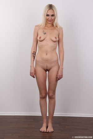 Slim blonde girl with a tattoo stands a  - XXX Dessert - Picture 14