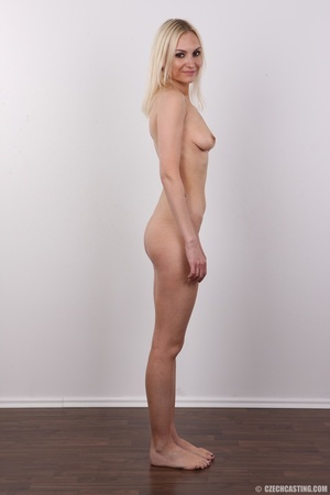 Slim blonde girl with a tattoo stands a  - XXX Dessert - Picture 15