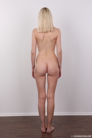 Slim blonde girl with a tattoo stands a  - XXX Dessert - Picture 16