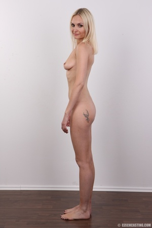 Slim blonde girl with a tattoo stands a  - XXX Dessert - Picture 17