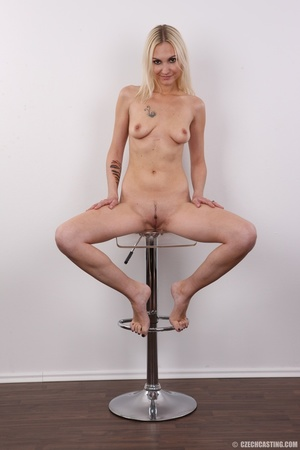 Slim blonde girl with a tattoo stands a  - XXX Dessert - Picture 19