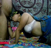 Indian masked MILF in a white bra and sari sucking her hubby's boner