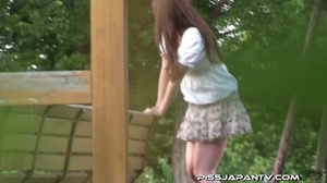 Cute Asian in sexy short skirt pressed on the streets hides to pee behind bench - XXXonXXX - Pic 8