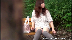 Naughty camera catches pressed Asian sexy babes spraying piss in public - XXXonXXX - Pic 1