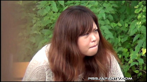 Naughty camera catches pressed Asian sexy babes spraying piss in public - XXXonXXX - Pic 2