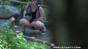 Naughty camera catches pressed Asian sexy babes spraying piss in public - XXXonXXX - Pic 9