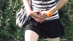 Naughty camera catches pressed Asian sexy babes spraying piss in public - XXXonXXX - Pic 11
