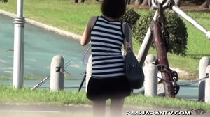 Naughty camera catches pressed Asian sexy babes spraying piss in public - XXXonXXX - Pic 16