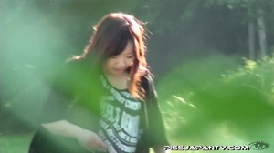 Young Asian hotties in public look for quiet play to spray piss outdoors - XXXonXXX - Pic 1