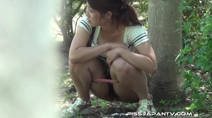 Young Asian babe on phone keeps talking as she finds a corner to piss outdoors - XXXonXXX - Pic 12