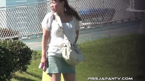 Chicks pissing outdoor gets interrupted but still spray water right out in public - XXXonXXX - Pic 14