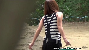 Asian beauty in stripped top and babe in short skirt bend and pee in public - XXXonXXX - Pic 8