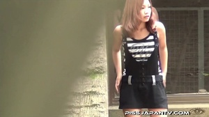 Young Asian babes pissing outdoors and wetting their clothes and shoes - XXXonXXX - Pic 6