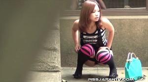 Young Asian babes pissing outdoors and wetting their clothes and shoes - XXXonXXX - Pic 8