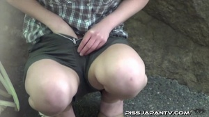 Young Asian babes pissing outdoors and wetting their clothes and shoes - XXXonXXX - Pic 15
