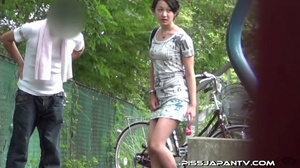 Slim Asian babe in tight jeans skirt bends twice to piss outdoors and wets self - XXXonXXX - Pic 3