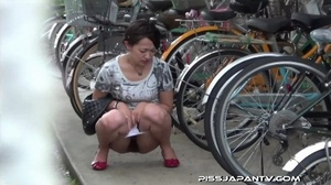 Slim Asian babe in tight jeans skirt bends twice to piss outdoors and wets self - XXXonXXX - Pic 4
