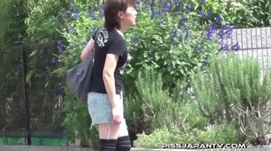 Slim Asian babe in tight jeans skirt bends twice to piss outdoors and wets self - XXXonXXX - Pic 7