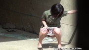 shy asian taking pee