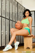 Flawless coquette in green athletic wear does a cock in the locker room.