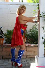 Wide ass blonde sex hero in red and blue super hero costume shows tits and ass