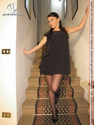 Naughty chick in sexy black dress shows hot long legs and feet in colorful hose - XXXonXXX - Pic 1