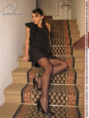 Naughty chick in sexy black dress shows hot long legs and feet in colorful hose - XXXonXXX - Pic 2
