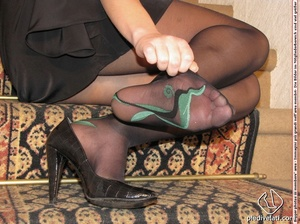 Naughty chick in sexy black dress shows hot long legs and feet in colorful hose - XXXonXXX - Pic 7