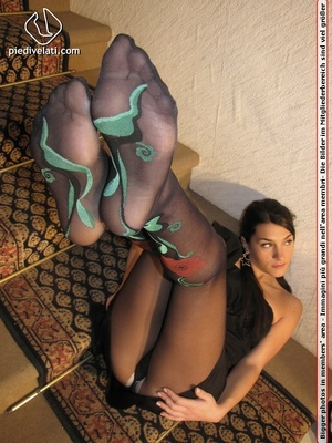Naughty chick in sexy black dress shows hot long legs and feet in colorful hose - XXXonXXX - Pic 14