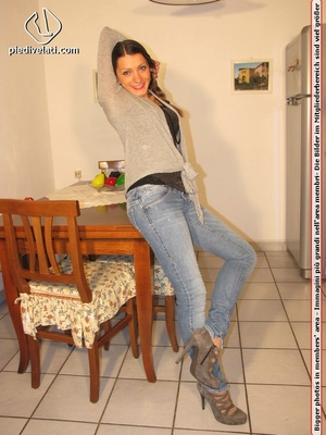 Cute chick in tight blue jeans drops shoes to display sweet cute feet on table - XXXonXXX - Pic 1