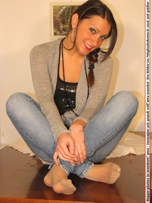 Cute chick in tight blue jeans drops shoes to display sweet cute feet on table - XXXonXXX - Pic 12