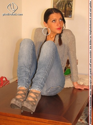 Cute chick in tight blue jeans drops shoes to display sweet cute feet on table - XXXonXXX - Pic 15