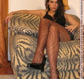 Hot enchantress in sexy outfit nylon pantyhose shows off sweet legs and