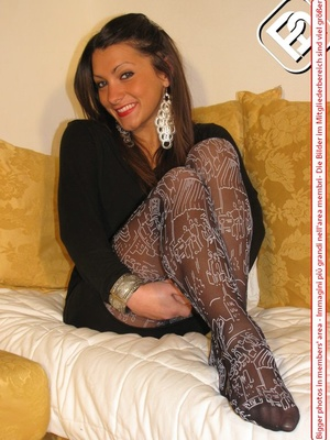 Pretty babe in black dress and heels shows hot legs in black and white pantyhose - XXXonXXX - Pic 4
