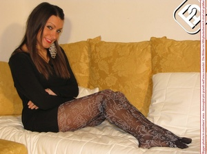 Pretty babe in black dress and heels shows hot legs in black and white pantyhose - XXXonXXX - Pic 5