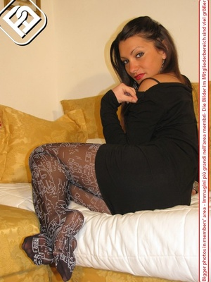 Pretty babe in black dress and heels shows hot legs in black and white pantyhose - XXXonXXX - Pic 8