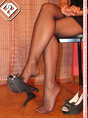 Sexy girl in hot short black dress sits on chair to display cute tempting feet - XXXonXXX - Pic 5