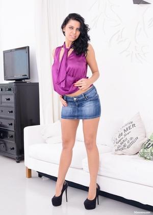 Busty brunette hottie in a purple top an - XXX Dessert - Picture 1